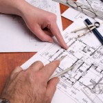 Engineers, Architects and Contractors work on plans